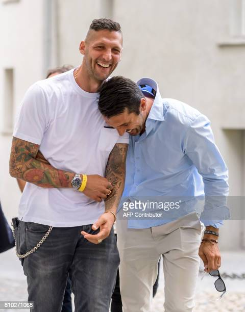 Italian football player Marco Materazzi and Italian goalkeeper Gianluigi Buffon share a light moment upon their arrival to take part to the Gianni's...