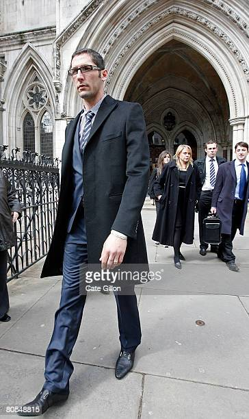 Italian football player Marco Materazzi walks outside the High Court on April 7 2008 in London England Materazzi accepted an apology regarding claims...