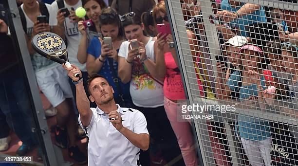 Italian football star Francesco Totti performs paddletennis during Rome's ATP tennis Masters on May 12 2014 in Rome AFP PHOTO / TIZIANA FABI