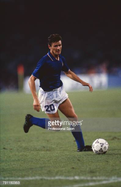 Italian footballer Aldo Serena makes a run with the ball during the semi final match between Argentina and Italy in the 1990 FIFA World Cup at the...
