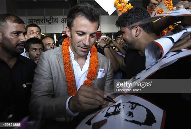 Italian footballer Alessandro Del Piero signs autographs for fans at IGI Airport on September 18 2014 in New Delhi India 2006 Italian World Cup...