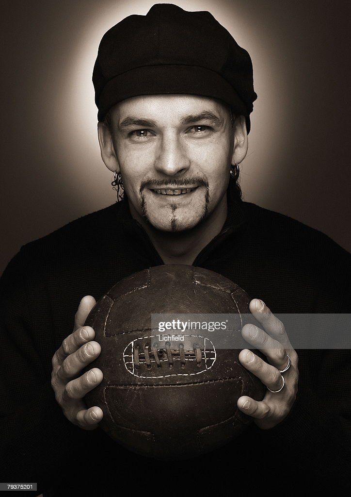 Italian footballer <a gi-track='captionPersonalityLinkClicked' href=/galleries/search?phrase=Roberto+Baggio&family=editorial&specificpeople=216586 ng-click='$event.stopPropagation()'>Roberto Baggio</a>, striker for Brescia and the Italian national team, holding an old fashioned leather football, 5th December 2003. (Photo by Lichfield/Getty Images).