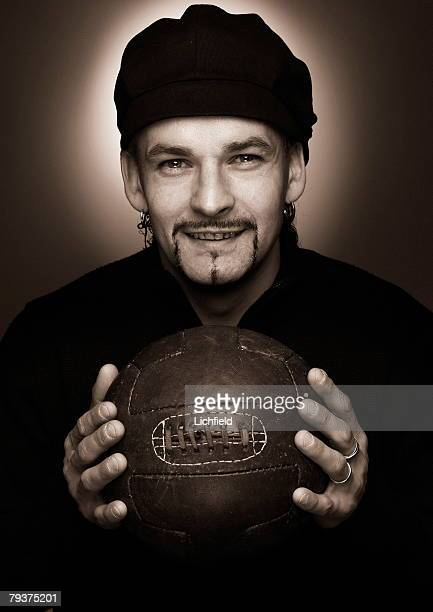 Italian footballer Roberto Baggio striker for Brescia and the Italian national team holding an old fashioned leather football 5th December 2003