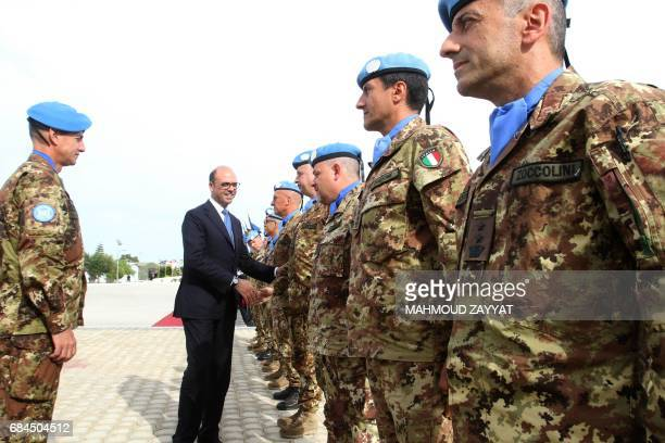 Italian Foreign Minister Angelino Alfano greets Italian members of the UN Interim Force in Lebanon as he visits the Italian UNIFIL headquarters in...