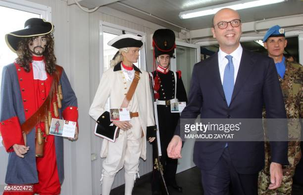 Italian Foreign Minister Angelino Alfano walks past mannequins wearing 16th century Italian army uniforms as he visits the Italian UNIFIL...