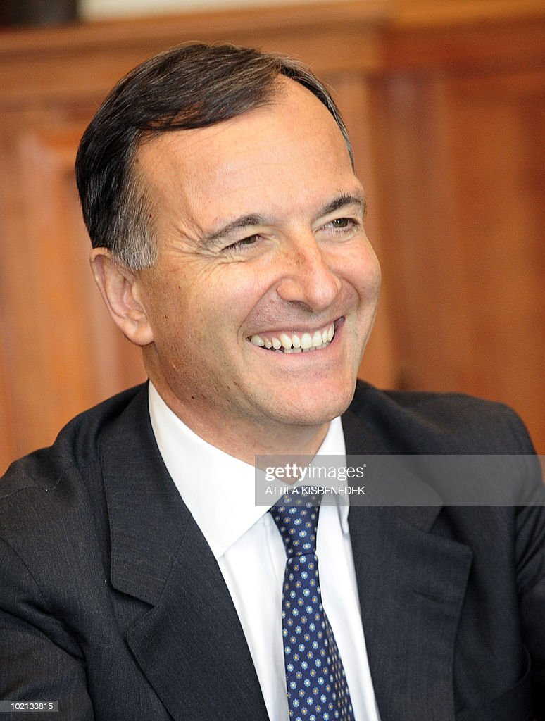 Italian Foreign Minister Franco Frattini listens to his Hungarian counterpart Janos Martonyi (not pictured) at the ministry of Foreign Affairs in Budapest on June 16, 2010 during their meeting. Frattini is on a one-day official visit to Hungary.