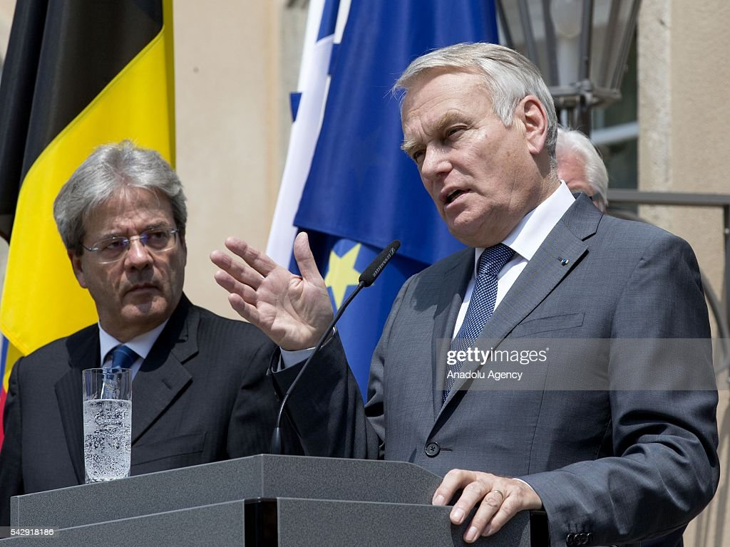Italian Foreign Minister Paolo Gentiloni (L) and French Foreign Minister Jean-Marc Ayrault (R) attend a press conference after their meeting to discuss United Kingdom's decision on leaving European Union (EU), at German foreign ministry's guest house Villa Borsig in Berlin, Germany on June 25, 2016.