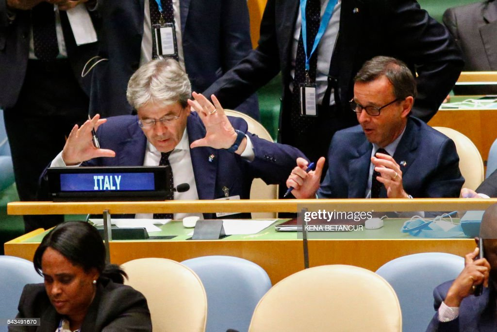 Italian Foreign Minister Paolo Gentiloni gestures as he gets ready to announce an agreement after the election of five non-permanent members of the Security Council at General Assembly hall at the United Nations in New York on June 28, 2016. / AFP / KENA