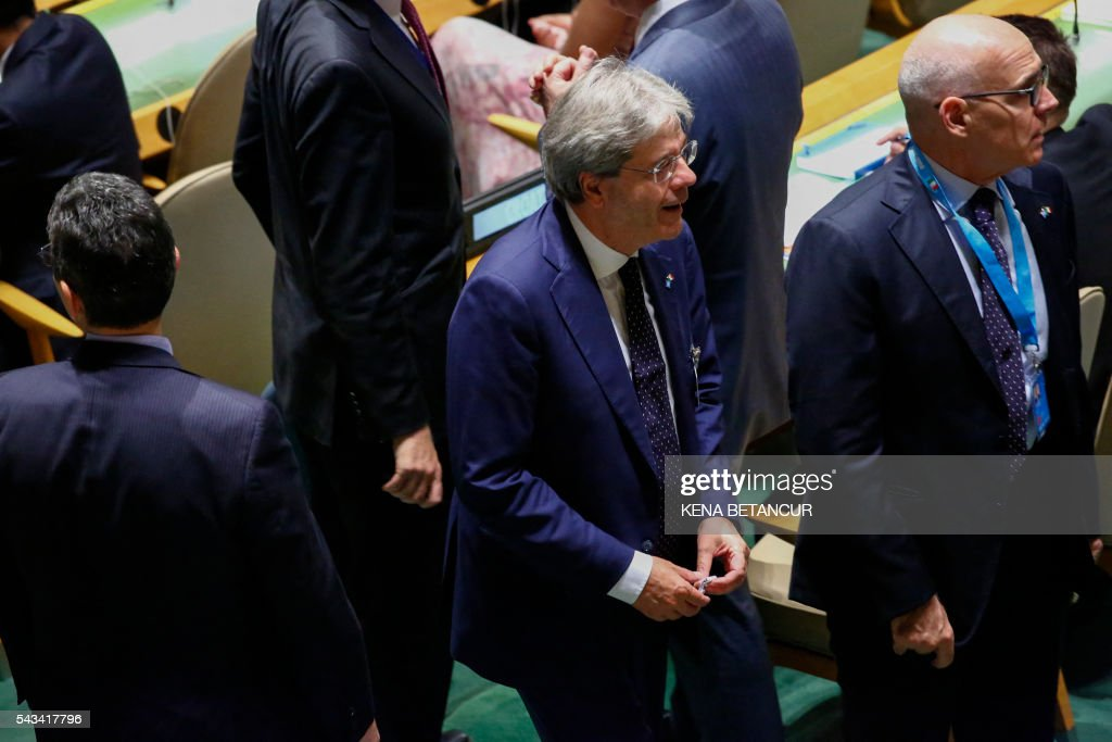 Italian Foreign Minister Paolo Gentiloni(C) is seen during Election of five non-permanent members of the Security Council at the general assembly hall at the United Nations in New York on June 28, 2016. Three European countries and two Asian nations are battling for seats on the UN Security Council in elections that are drawing attention to the refugee crisis and human rights. / AFP / KENA