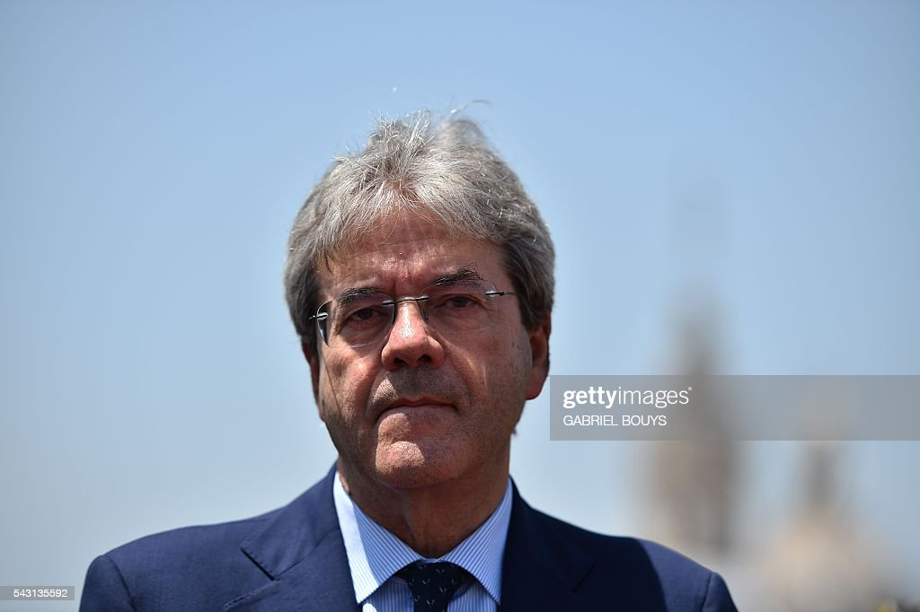Italian Foreign minister Paolo Gentiloni looks on during a meeting with US Secretary of State in Rome on June 26, 2016. After his visit to Rome, US Secretary of State John Kerry will fly to Brussels and London on June 27, 2016 for crisis talks with top EU and British officials in the aftermath of Britain's vote to leave the European Union. / AFP / GABRIEL