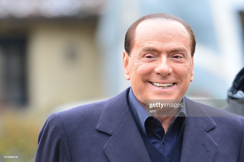 Italian former prime minister and owner of the AC Milan football team, Silvio Berlusconi, arrives at the AC Milan training grounds in Milanello on December 8 , 2012. Prime Minister Mario Monti's government hung by a thread the day before as predecessor Silvio Berlusconi prepared to return to the fray, with his supporters arguing that Italy is now far worse off than before.