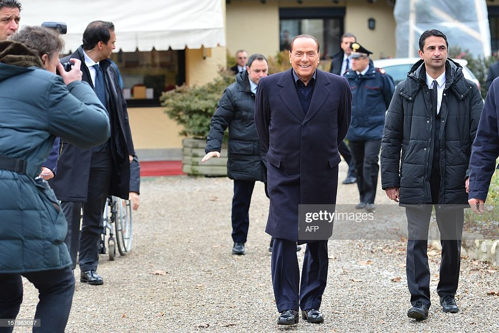 Italian former prime minister and owner of the AC Milan football team, Silvio Berlusconi, arrives at the AC Milan training grounds in Milanello on December 8 , 2012. Prime Minister Mario Monti's government hung by a thread the day before as predecessor Silvio Berlusconi prepared to return to the fray, with his supporters arguing that Italy is now far worse off than before. AFP PHOTO / GIUSEPPE CACACE