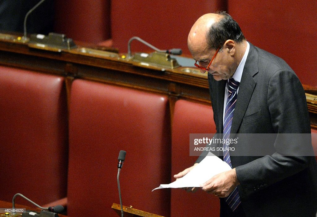 Italian former secretary of the Democratic Party Pier Luigi Bersani looks at a paper at the Italian Parliament in Rome on January 29 during a vote to...