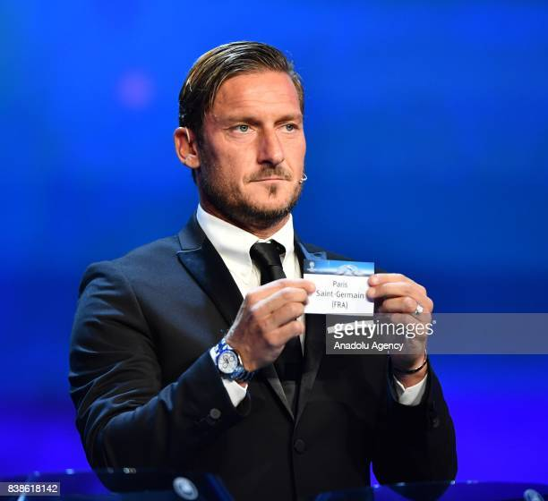 Italian former soccer player Francesco Totti draws Paris Saint Germain during the UEFA Champions League Group stage draw ceremony at the Grimaldi...