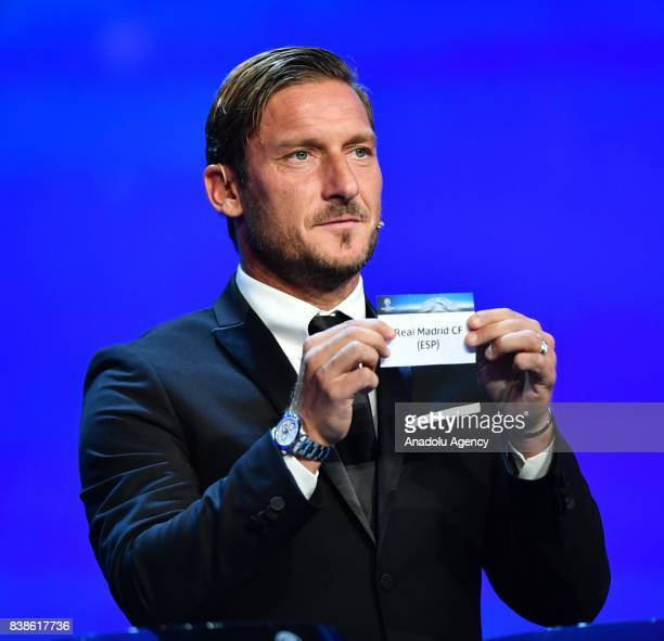 Italian former soccer player Francesco Totti draws Real Madrid during the UEFA Champions League Group stage draw ceremony at the Grimaldi Forum Monte...