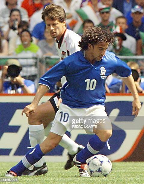 Italian forward Alessandro del Piero duels with Austrian Peter Schottel during the1998 Soccer World Cup group B first round match between Italy and...