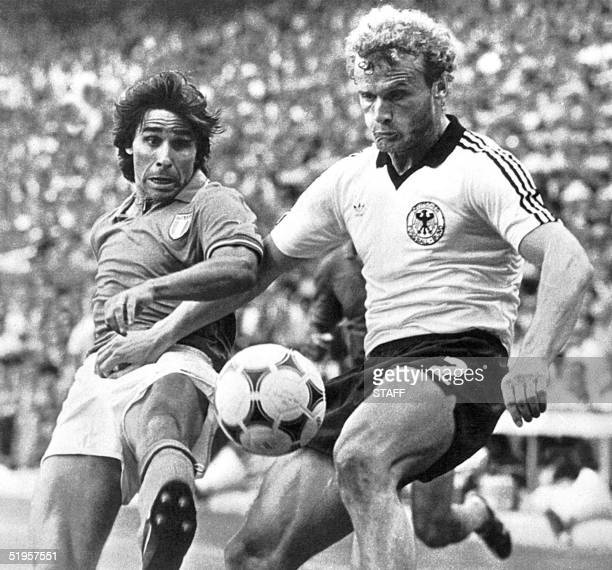 Italian forward Bruno Conti battles for the ball with West German midfielder Hans Peter Briegel 11 July 1982 in Madrid during the World Cup soccer...