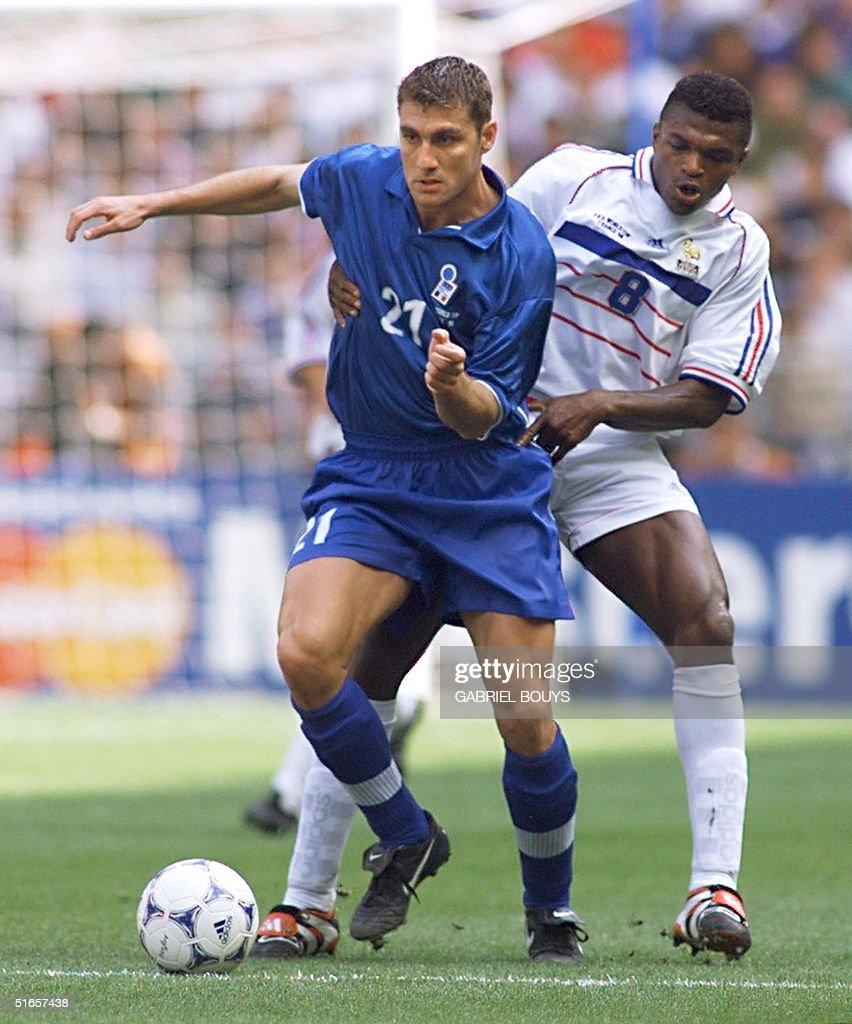 Italian forward Christian Vieri L is challenged