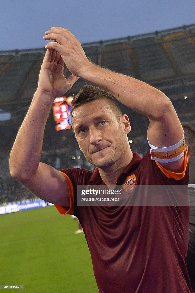 Italian forward Francesco Totti greets fans at the end of the Italian Serie A football match AS Roma vs Lazio on January 11, 2015 in Rome.