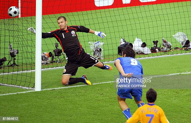 Italian forward Luca Toni scores past Romanian goalkeeper Bogdan Lobont and Romanian mildfielder Florentin Petre during the Euro 2008 Championships...