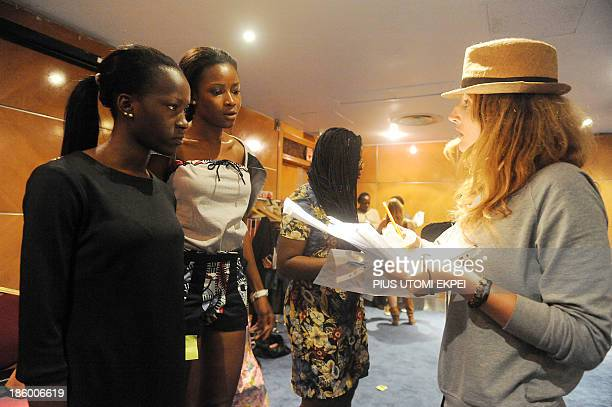 Italian founder of Nigerian based Kinabuti fashion label Caterina Bortolussi speaks to models during a rehearsal of the Lagos Fashion and Design Week...