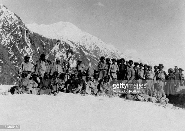 Italian geologist and geographer Giotto Dainelli posing with his guides on the Siachen glacier India 1930s