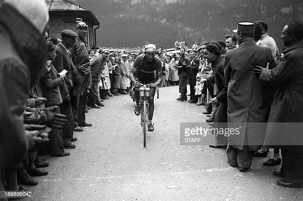 Italian Gino Bartali rides uphill in the Col de la Forclaz on his way to winning the 15th stage of the Tour de France between AixlesBains and...