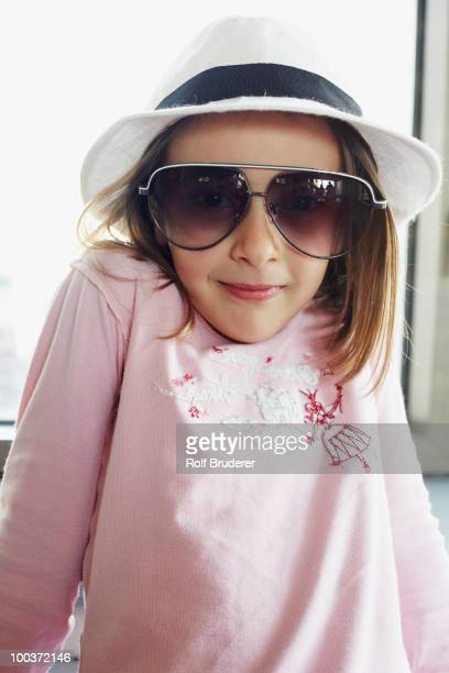 Italian girl in fedora and sunglasses