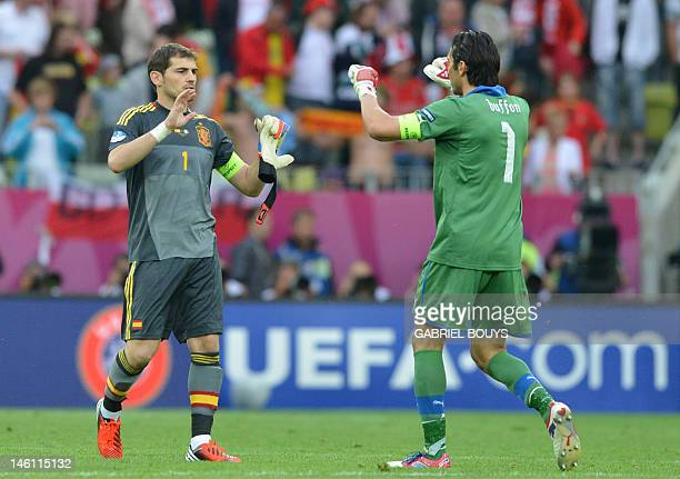Italian goalkeeper Gianluigi Buffon and Spanish goalkeeper Iker Casillas congratulate each other at the end of the Euro 2012 championships football...