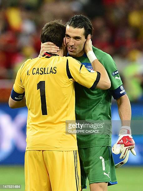 Italian goalkeeper Gianluigi Buffon congratulates Spanish goalkeeper Iker Casillas during the Euro 2012 football championships final match Spain vs...