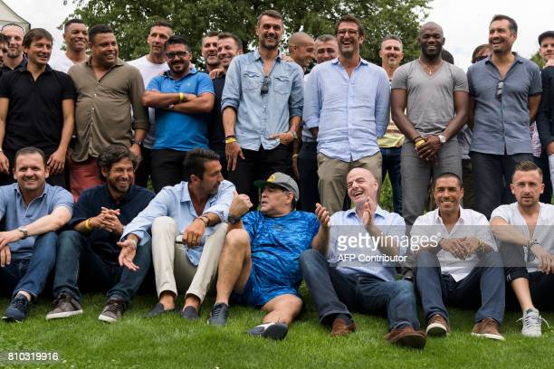 Italian goalkeeper Gianluigi Buffon former Argentinian football star Diego Maradona and FIFA President Gianni Infantino pose with others prior to...