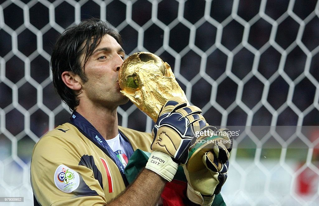 Italian goalkeeper Gianluigi Buffon kisses the trophy after the World Cup 2006 final football game Italy vs.France, 09 July 2006 at Berlin stadium. Italy won the 2006 football World Cup by defeating France on penalties.