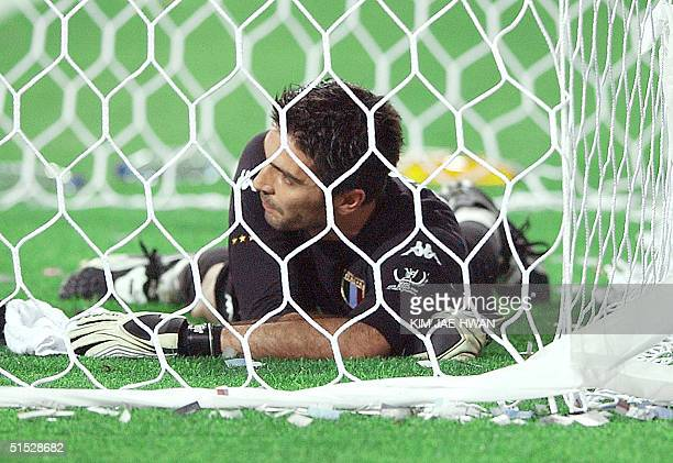 Italian goalkeeper Gianluigi Buffon lies on the ground in dejection after allowing the winning goal in extra time against South Korea in the second...