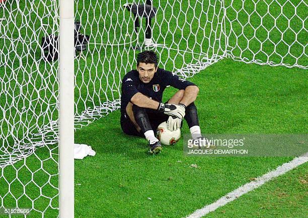 Italian goalkeeper Gianluigi Buffon sits looking dejected after allowing a 'golden goal' by South Korean midfielder Ahn Junghwan late in extra time...