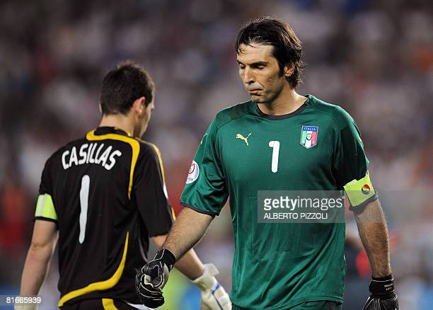 Italian goalkeeper Gianluigi Buffon walks by Spanish goalkeeper Iker Casillas during the penalty shootouts at the Euro 2008 Championships...