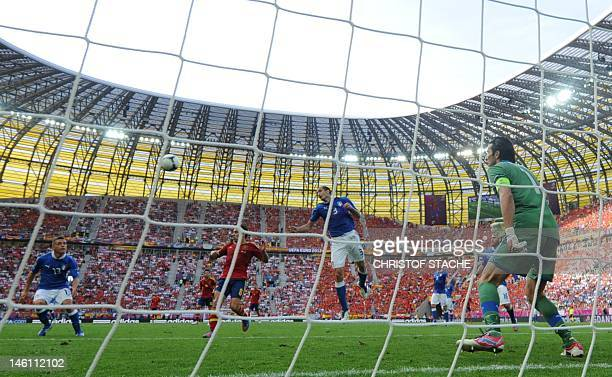 Italian goalkeeper Gianluigi Buffon watches his defensers in action during the Euro 2012 championships football match Spain vs Italy on June 10 2012...