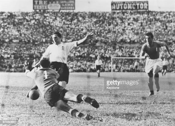 Italian goalkeeper Valerio Bacigalupo attempts to save a shot from England's Tommy Lawton during an international at the Stadio Comunale Turin Italy...