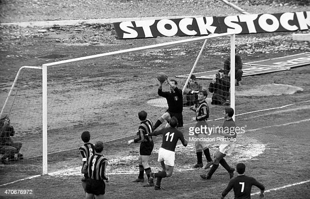 'Italian goalkeeper wearing the Inter suit Giuliano Sarti and Italian football player wearing the Inter suit Giacinto Facchetti defending their...