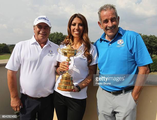Italian golf player Costantino Rocca Marco Simone golf club President Lavinia Biagiotti Scotland golf player Sam Torrance pose with the Ryder Cup...