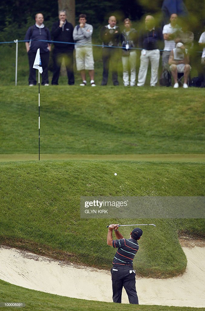 Italian golfer Francesco Molinari plays out of a greenside bunker at the 2nd on the first day of the PGA Championship on the West Course at Wentworth, central England, on May 20, 2010.