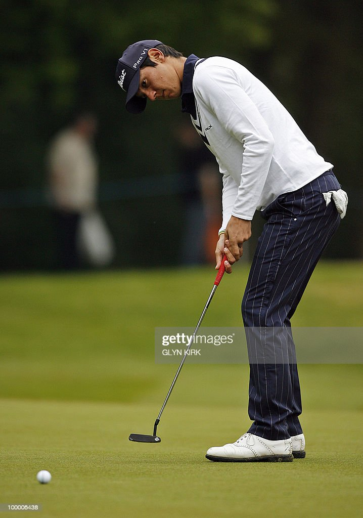 Italian golfer Matteo Manassero lines plays a putt shot on the 1st green on the first day of the PGA Championship on the West Course at Wentworth, central England, on May 20, 2010.