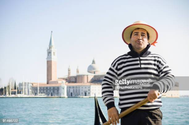 Italian gondolier with church in background