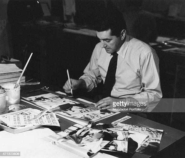 Italian graphic designer Mario Mengaldo putting together a layout of the weekly magazine Epoca Italy 1960s