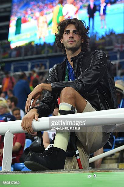 Italian high jumper Gianmarco Tamberi looks on as the watches a medal ceremony at the athletics at the Rio 2016 Olympic Games at the Olympic Stadium...