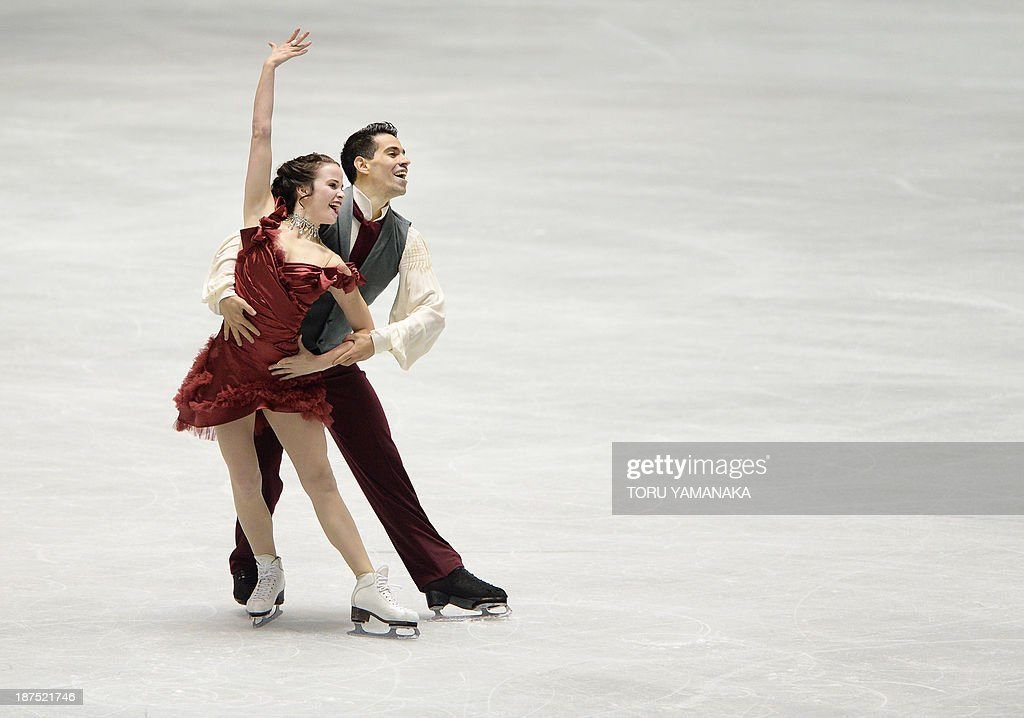 Italian ice dance skaters Anna Cappellini (L) and Luca Lanotte (R) perform during their free dance event in the NHK Trophy, the fourth leg of the six-stage ISU figure skating Grand Prix series, in Tokyo on November 10, 2013. AFP PHOTO/Toru YAMANAKA