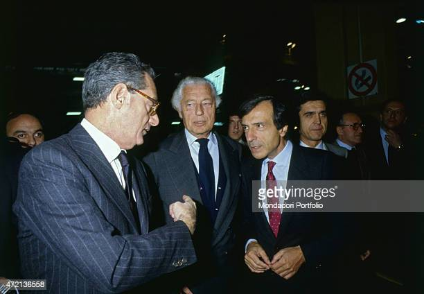'Italian industrialist and politician Gianni Agnelli president of FIAT talking with Italian industrialists Vittorio Ghidella and Cesare Romiti at a...