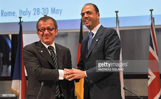 Italian interior minister Roberto Maroni shakes hands with Italian Justice minister Angelino Alfano prior a joint press conference at the end of a...