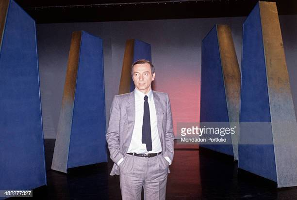 Italian Italian science journalist television presenter and writer Piero Angela standing with his hands in his pocket in the studio of the broadcast...
