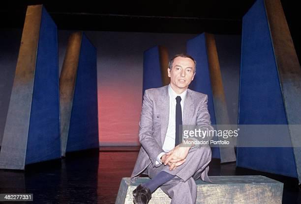 Italian Italian science journalist television presenter and writer Piero Angela sitting in the studio of the broadcast Quark Italy 1981