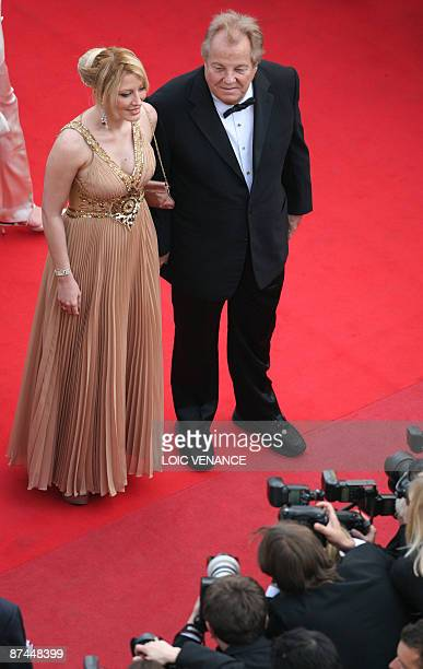 Italian jetsetter Massimo Gargia arrives with French TV reality star Loana for the screening of the movie 'Vengeance' in competition at the 62nd...
